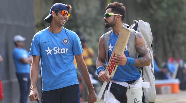Indian Cricketers Virat Kohli and Ashish Nehra during Practice Session